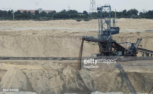 Minero de carbón en una pit : Foto de stock