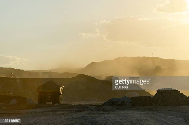 Coal mining truck hauling dirt on a hazy day