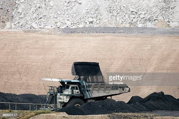 A coal truck is loaded at BHP Billiton's Mt Arthur coal mine February 15 2006 in Muswellbrook Australia BHP today posted the biggest interim profit...