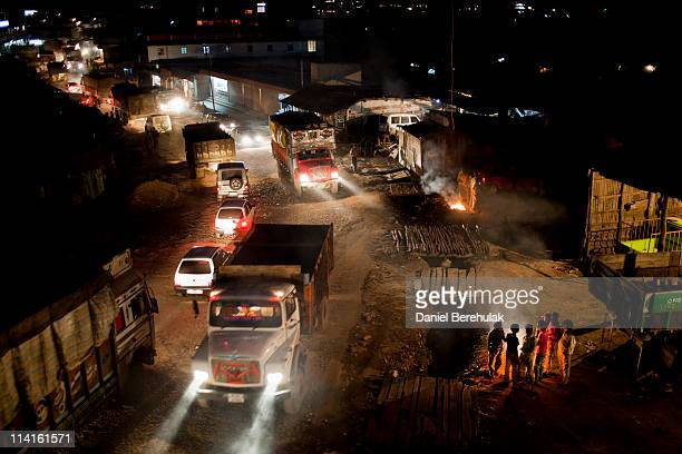 Coal trucks and other vehicles move through town after being delayed due to a traffic accident on April 15 2011 in Lad Rymbai in the district of...