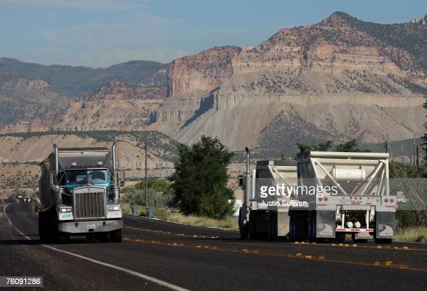 Coal trucks drive alone highway 31 August 14 2007 near Huntington Utah Rescuers continue to search for the six miners that have been trapped 1500...