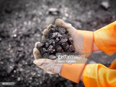 Coal Worker With Handful Of Coal