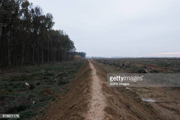 Coal workers have built a mud wall at the border between the mine and the forest which helps prosecuting any activist venturing on the mine's...