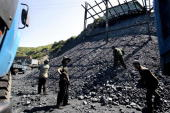 Coal workers load trucks at a coal mine in rural Shanxi province 30 May 2004 west of the Taiyuan in China's biggest coalproducing province China huge...