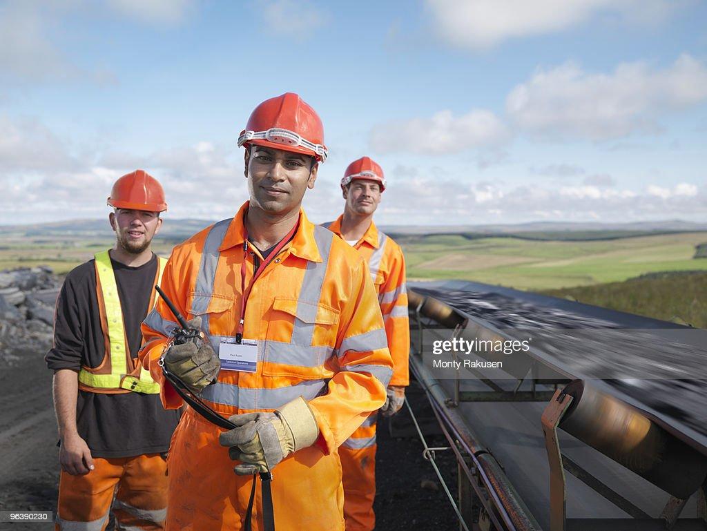 Coal Workers With Conveyor Belt