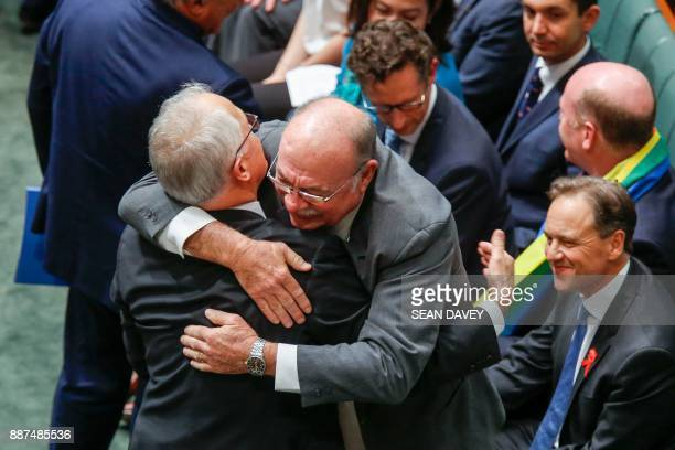 Coalition Member Warren Entsch hugs Australia's Prime Minister Malcolm Turnbull after the parliament passed the samesex marriage bill in the Federal...