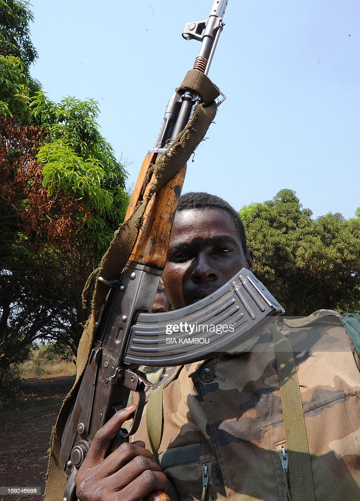 A SELEKA coalition rebel in the Central African Republic poses with his gun as rebels patrol on roads 12kms from the city of Damara, on January 10, 2013, close to where soldiers of the FOMAC multinational force of central African states are stationed, to create a buffer zone between rebels and troops loyal to the current government. Meanwhile peace talks to resolve the Centrafrican rebel crisis were suspended until today, with no settlement in sight after the rebels demanded that President Francois Bozize resign and be brought before the International Criminal Court for war crimes.