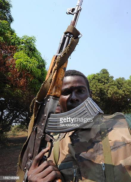 A SELEKA coalition rebel in the Central African Republic poses with his gun as rebels patrol on roads 12kms from the city of Damara on January 10...