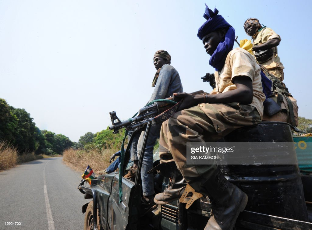 SELEKA coalition rebels in the Central African Republic patrol on roads 12kms from the city of Damara, on January 10, 2013, close to where soldiers of the FOMAC multinational force of central African states are stationed, to create a buffer zone between rebels and troops loyal to the current government. Meanwhile peace talks to resolve the Centrafrican rebel crisis were suspended until today, with no settlement in sight after the rebels demanded that President Francois Bozize resign and be brought before the International Criminal Court for war crimes.