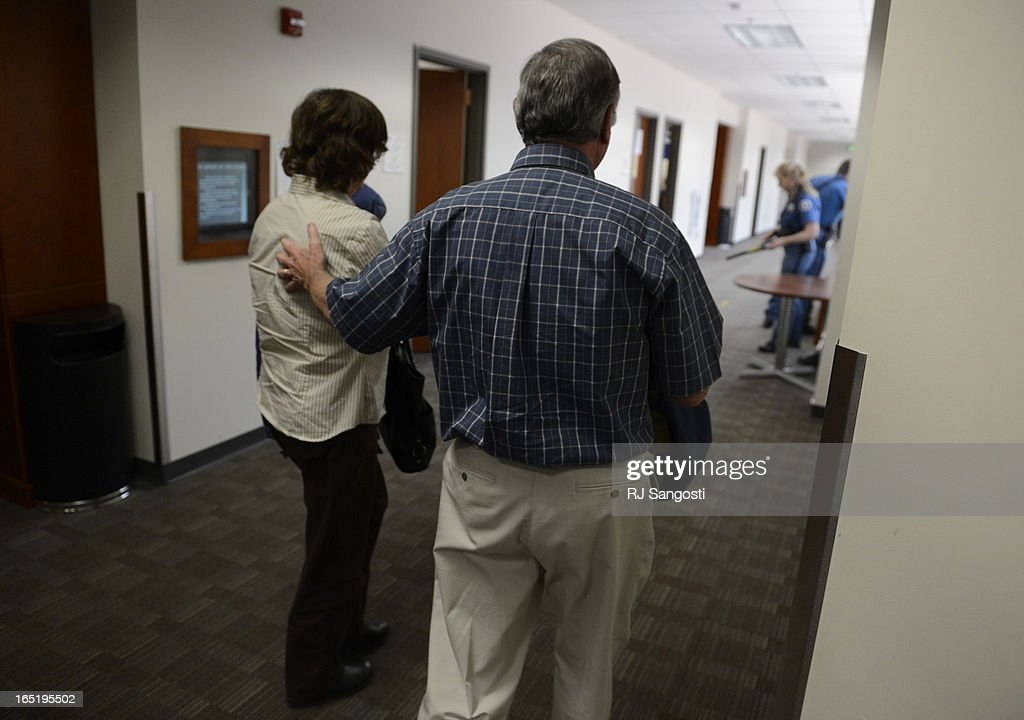 Parents Arlene and Robert Holmes, of Aurora theater shooting suspect James Holmes, head back into courtroom, Monday April 01, 2013. Earlier that day they learned prosecution will go for the death penalty in their son case.