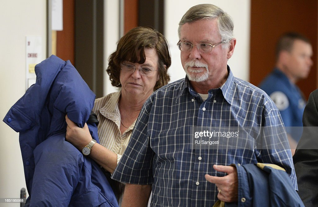 Parents Arlene and Robert Holmes, of Aurora theater shooting suspect James Holmes, leave the courtroom, Monday April 01, 2013. Earlier that day they learned prosecution will go for the death penalty in their son case.