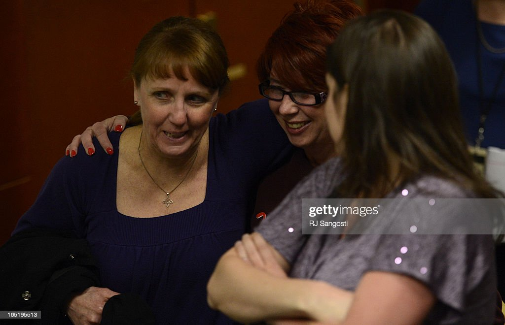Victims and family of victims head out of court, for Aurora theater shooting suspect James Holmes, after hearing the news that prosecution will go forth with the death penalty case, Monday April 01, 2013.