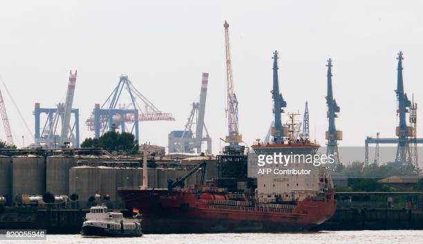 A coast freight ship locked at the port of the Hamburg harbour in Hamburg northern Germany on July 20 2017 / AFP PHOTO / PATRIK STOLLARZ