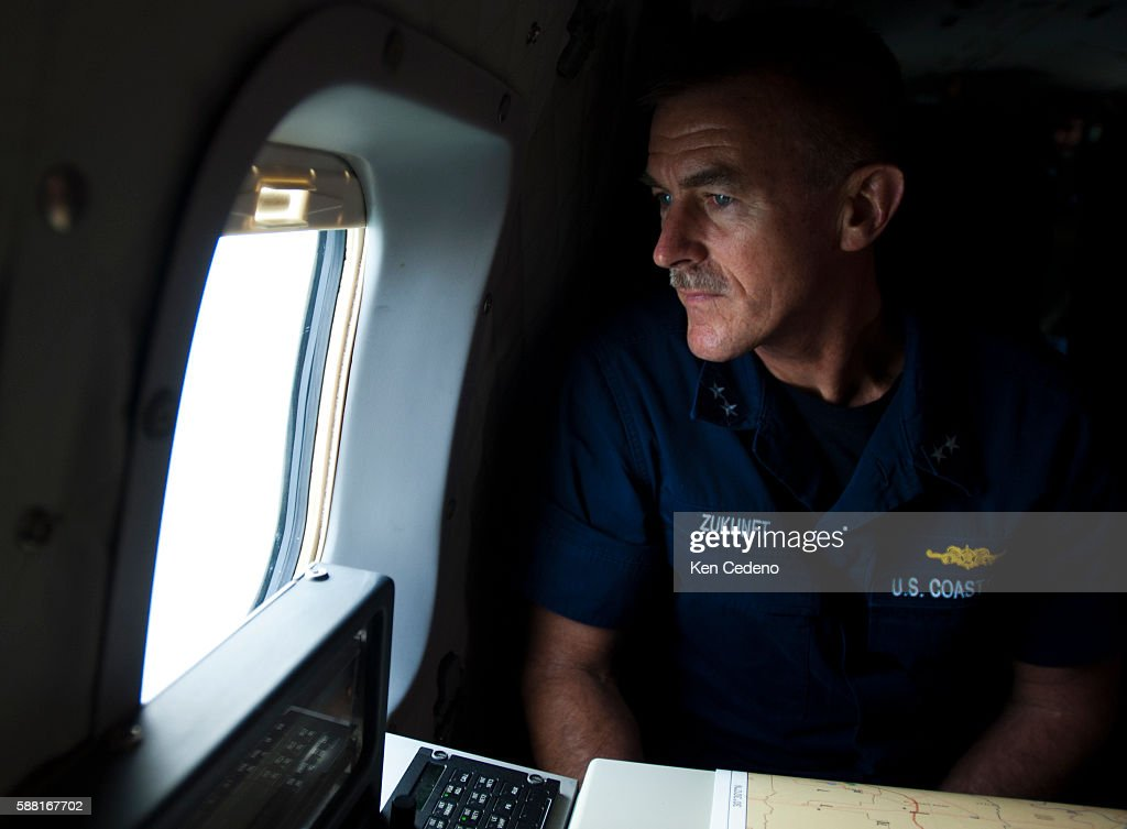Coast Guard Admiral Paul Zukunft looks out the window of a C144 flying toward the Deep Water horizon oil spill where it's containment efforts are...