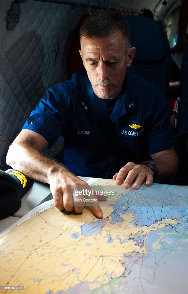 Coast Guard Admiral Paul Zukunft points on a map where the Deep Water horizon oil spill containment efforts are being done July 11 2010 BP is...