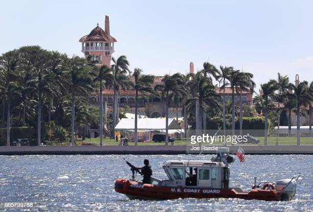 Coast Guard boat is seen patrolling in front of the MaraLago Resort where President Donald Trump held meetings with Chinese President Xi Jinping on...