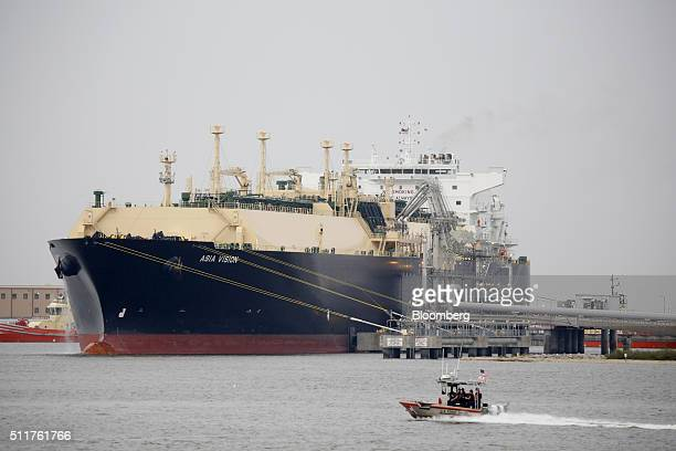A US Coast Guard boat moves past the Asia Vision LNG carrier ship docked at a terminal in Sabine Pass Texas US on Monday Feb 22 2016 The first tanker...