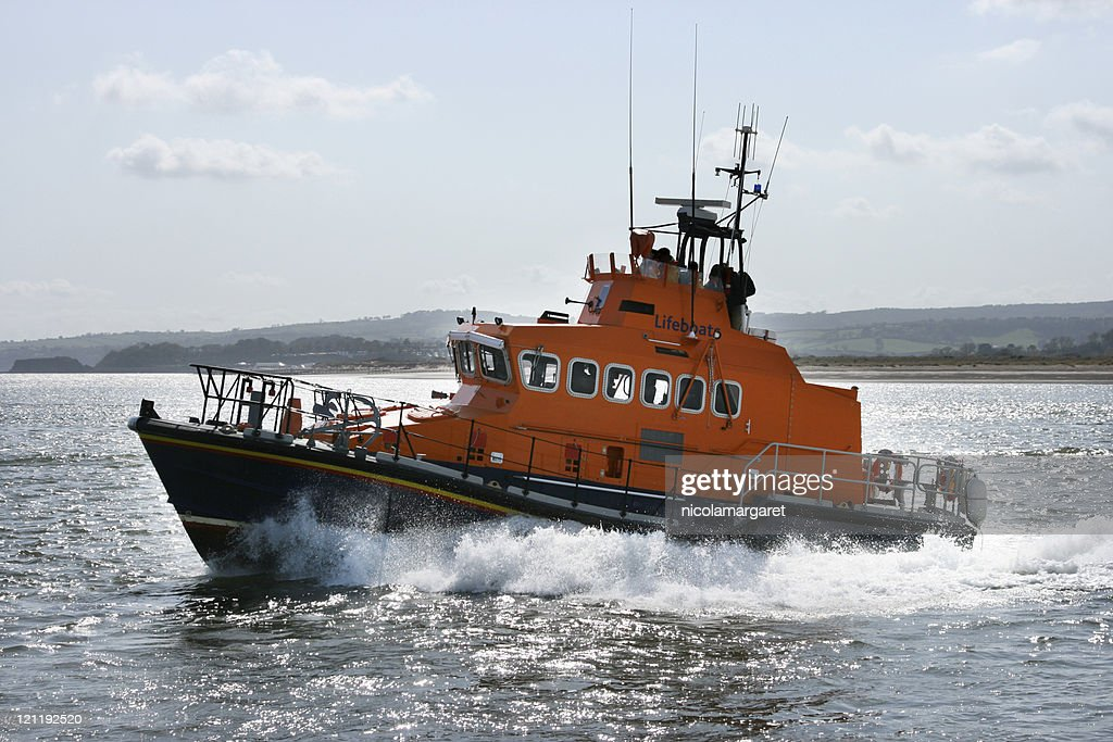 Coast guard boat moving quickly through the sea