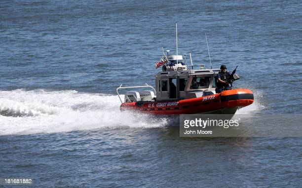 S Coast Guard boat patrols the East River near the United Nations building ahead of the 68th session of the General Assembly on September 23 2013 in...