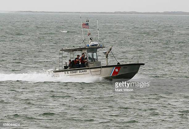 S Coast Guard boat patrols the waters near NASA's Wallops Flight Facility October 29 2014 in Atlantic Virginia An unmanned Orbital Sciences...
