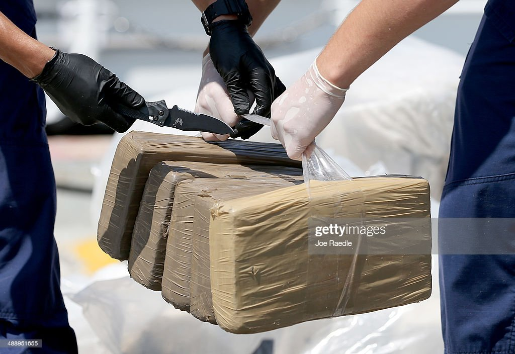 U.S. Coast Guard crew members off load blocks of marijuana from the Paul Clark one of the Coast Guard's newest fast-response cutters on May 9, 2014 in Miami Beach, Florida. The U.S. Coast Guard used two of the new fast-response cutters to seize the more than $3 million in drugs earlier this month on the Caribbean Sea in separate interdictions just a day apart from each other.