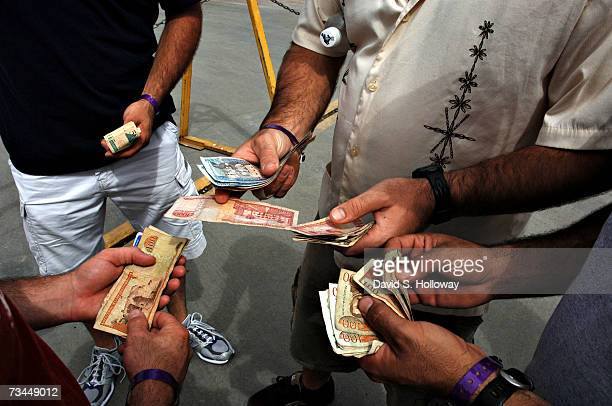 S Coast Guard crew members on liberty exchange Dominican pesos October 29 2006 in Santo Domingo Dominican Republic The crew had two days to be...