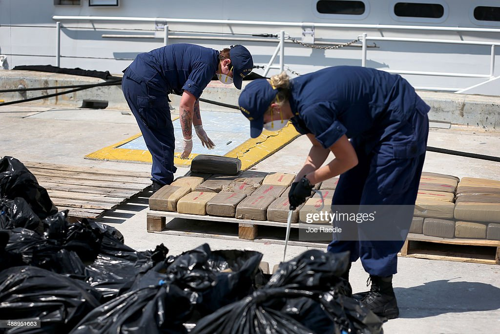 U.S. Coast Guard crew members stack blocks of marijuana as they off load it from the Paul Clark one of the Coast Guard's newest fast-response cutters on May 9, 2014 in Miami Beach, Florida. The U.S. Coast Guard used two of the new fast-response cutters to seize the more than $3 million in drugs earlier this month on the Caribbean Sea in separate interdictions just a day apart from each other.