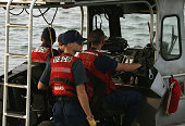 Coast Guard crew patrols the waters near NASA's Wallops Flight Facility October 29 2014 in Chincoteague Island Virginia Last night an unmanned...