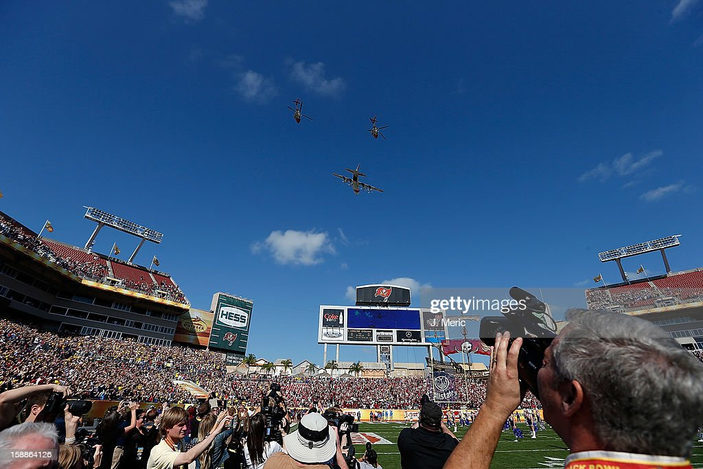 A Coast Guard flyover just before the start of the Outback Bowl Game between the South Carolina Gamecocks and the Michigan Wolverines at Raymond James Stadium on January 1, 2013 in Tampa, Florida.