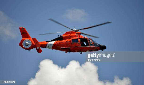 A US Coast Guard H65C Dolphin helicopter patrols the waters around the Dante B Fascell Port of MiamiDade County in Miami Florida US on Thursday Aug 8...
