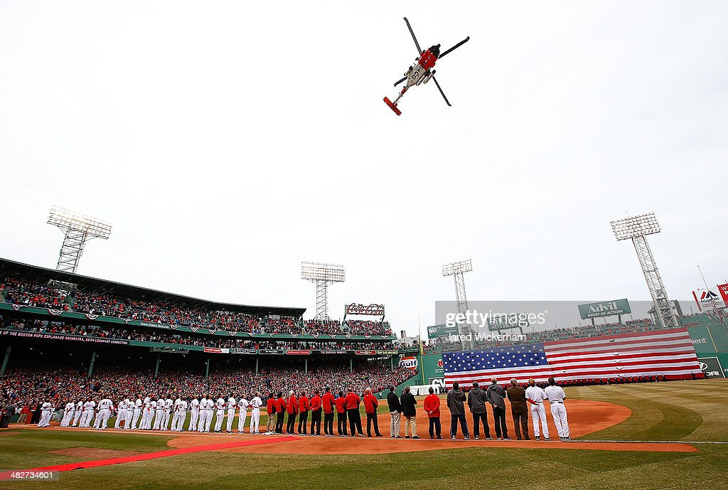 Coast Guard helicopter flies over Fenway Park following the national anthem prior to the Opening Day Game between the Boston Red Sox and the...