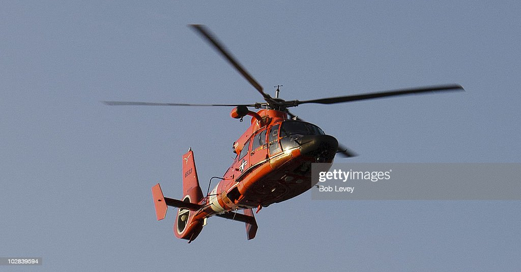 S Coast Guard helicopter performs a fly over before the Columbus Crew and the Houston Dynamo play during military appreciation night at Robertson...