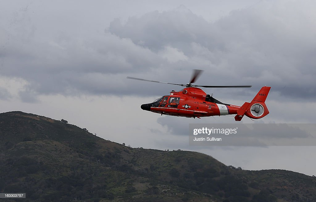 S Coast Guard HH65 Dolphin helicopter flies over Angel Island on March 7 2013 in San Francisco California The US Coast Guard is facing over $400...