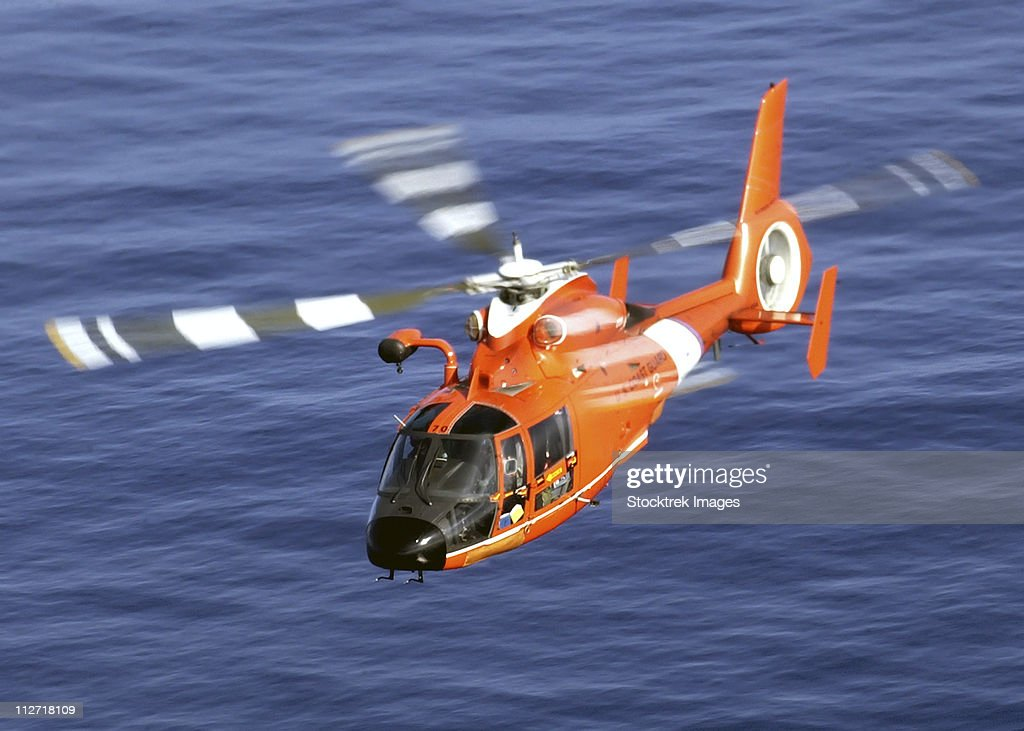 A Coast Guard HH-65A Dolphin rescue helicopter in flight.