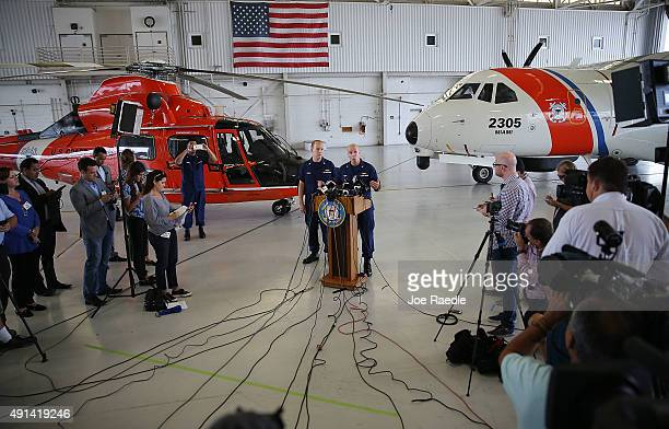 S Coast Guard Lt Commander Gabe Somma stands next to US Coast Guard Captain Mark Fedor as he speaks to the media at US Coast Guard Station Miami...