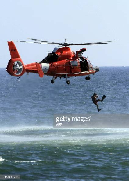 Coast Guard member dives from a helicopter during the celebration for the 100th anniversary of the Dominican Republic Air Force on March 26 2011 in...