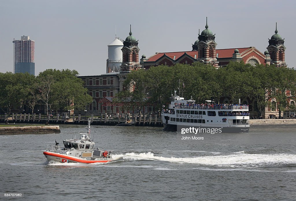 S. Coast Guard patrol moves through New York Harbor next to Ellis Island on May 27, 2016 in New York City. U.S. Secretary of Homeland Security Jeh Johnson visited the historic island to administer the oath of citizenship to immigrants from 39 countries. The ceremony, held by U.S. Citizenship and Immigration Services (USCIS), was held in honor of Memorial Day and is one of 100 naturalization ceremonies held in U.S. national parks in celebration of the National Park Service's 100th anniversary.