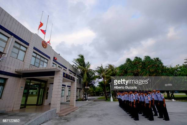 SPRATLY ISLANDS TAIWAN Coast Guard personal stationed in Taiping Island Itu Abe attending the country flag rising ceremony which is performed daily...