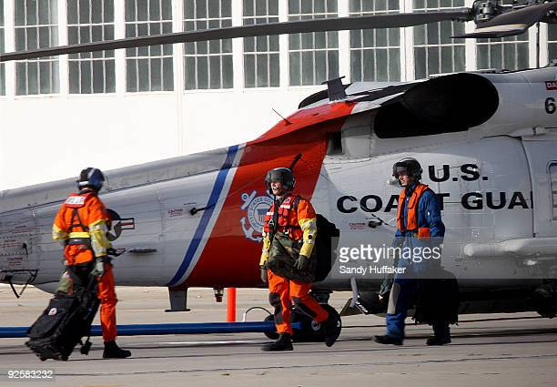 Coast Guard personnel depart on a search and rescue mission after a collision between a Marine Corps AH1W Super Cobra helicopter and a Coast Guard...