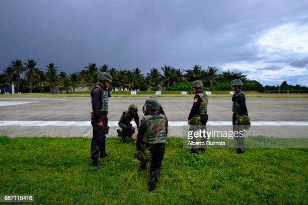SPRATLY ISLANDS TAIWAN Coast Guard personnel stationed in Taiping Island performing regular training aimed at defending the island The island which...