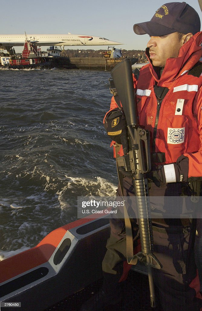 S Coast Guard Petty Officer Carlos Perez of Brooklyn New York patrols New York Harbor as a British Airways Concorde Jet is transported November 24...