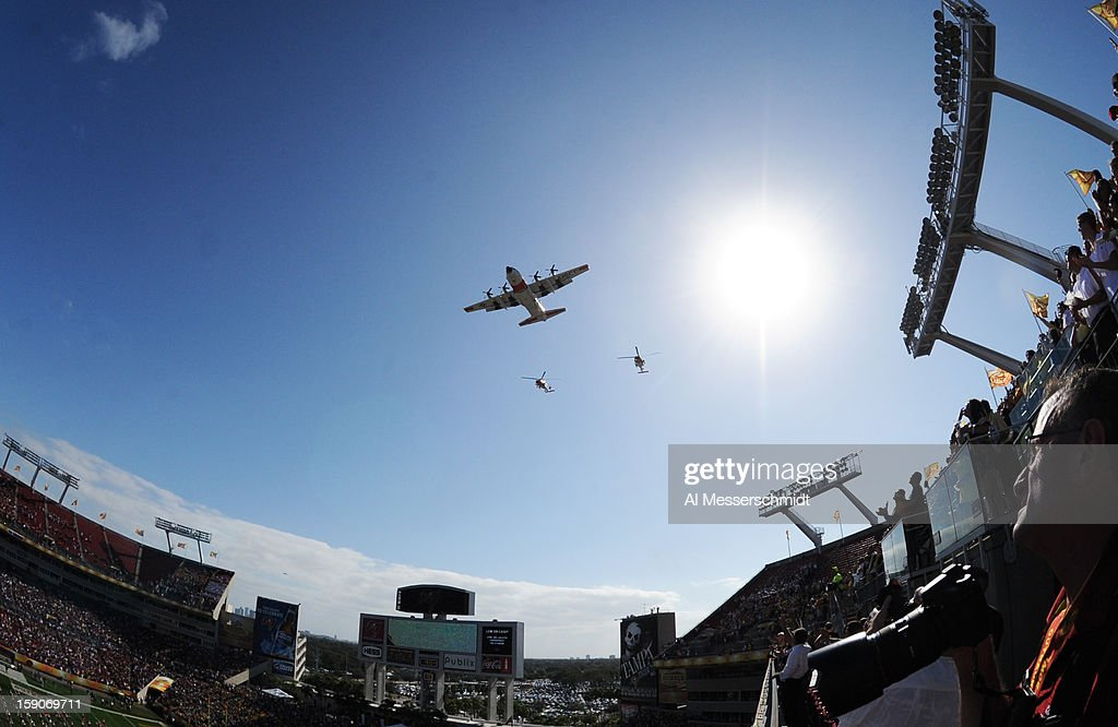 A U. S. Coast Guard plane and two helicopters fly over the stadium before the Michigan Wolverines play against the South Carolina Gamecocks in the Outback Bowl January 1, 2013 at Raymond James Stadium in Tampa, Florida.