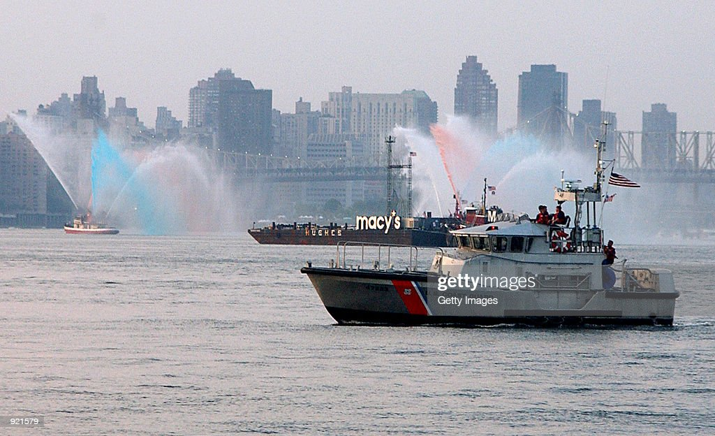 S Coast Guard rescue boat from Coast Guard Station Sandy Hook New Jersey patrols the East River near the Macy's fireworks barges July 4 2002 near New...