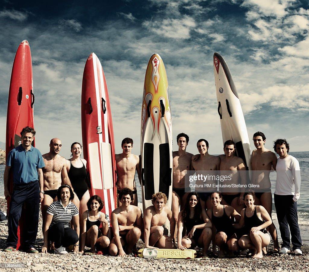 Coast guard rescue team posing on beach : Stock Photo
