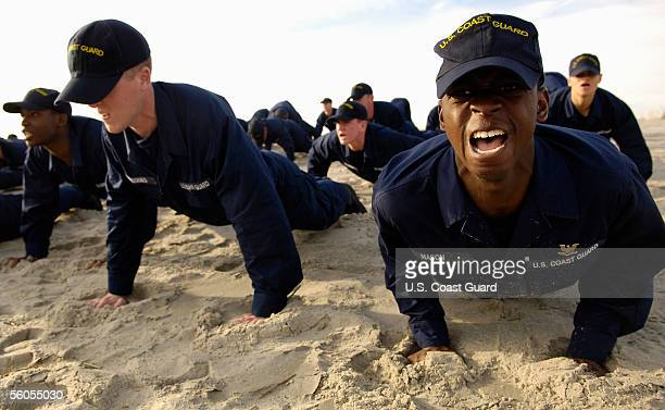S Coast Guard Seaman recruit Tarvaris Mason of Yulee Florida sounds off for his company commander during a training session on the beach at the Coast...