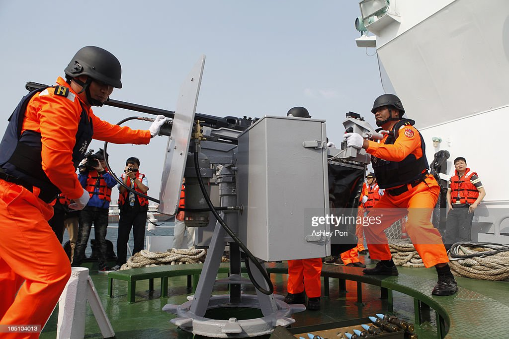 Coast guards operating a 20mm gun machine gun during an exercise on March 30, 2013 in Kaohsiung, Taiwan. President Ma Ying-jeou has unveiled two new ships that will patrol the waters off the disputed islands in the East China Sea at the centre of a current regional territorial row.