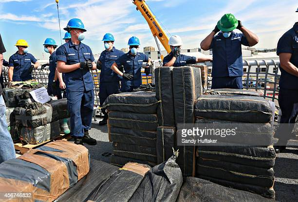 S Coast Guardsmen prepare to offload piles of confiscated cocaine seized during a 18 different interdictions off the coast of Central and South...
