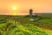 Acient tower on the coast of Co. Clare at sunset, Ireland