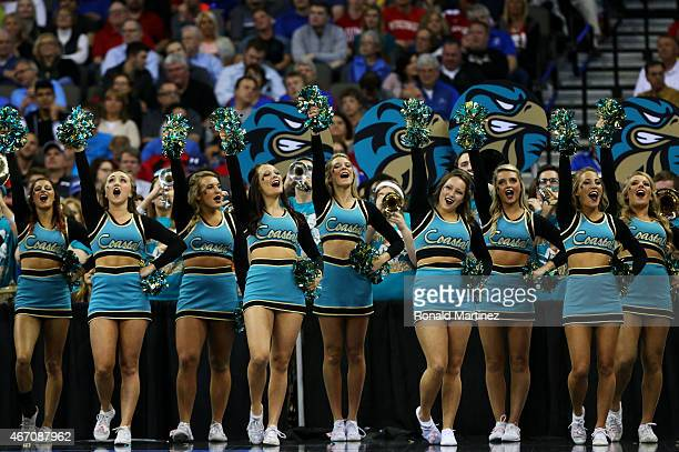 Coastal Carolina Chanticleers cheerleaders perform in the first half against the Wisconsin Badgers during the second round of the 2015 NCAA Men's...