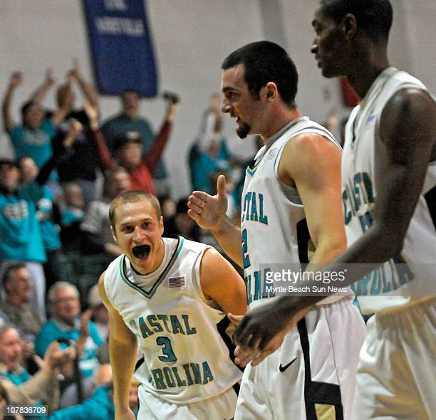 Coastal Carolina guard Anthony Raffa center smiles as he walks off the court at halftime after sinking a halfcourt shot at the buzzer against Radford...